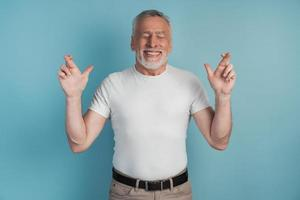 Portrait of a charming man with a beard raising his arms photo