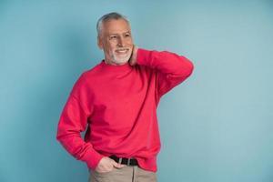 Handsome man in a bright crimson pullover photo