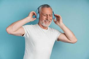 Mature gray-haired man has a great time photo