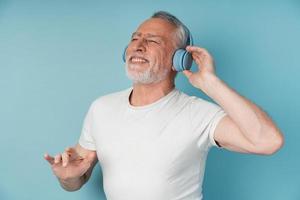 Attractive, mature man in headphones enjoys music photo