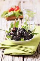Bowl of prunes photo