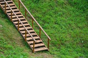 Wooden ladder for climbing the mountain. Climbing the stairs to photo