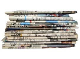 Newspapers isolated over white photo