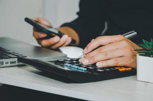 businessman using a calculator business tax financial or marketing photo