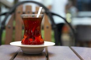 a glass of turkish tea on the table photo