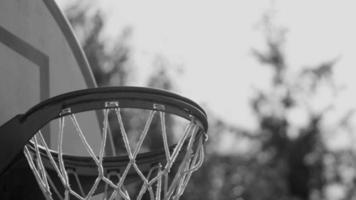 Basketball goes into hoop video