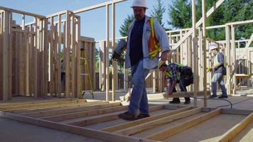 Construction worker using nail gun video