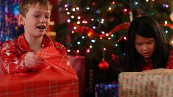 Kids opening Christmas gifts video