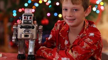 Portrait of boy with robot on Christmas video