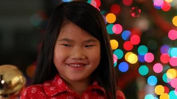 Young girl shaking Christmas bell video