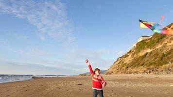 Girl flying kite at beach video