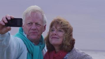 Senior couple taking selfie on beach video