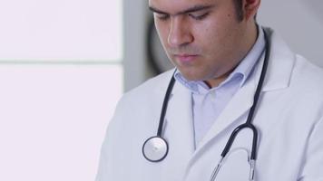 Closeup of doctor using digital tablet video