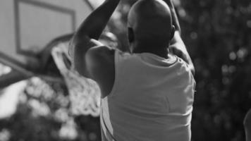 Basketball player shoots and scores video