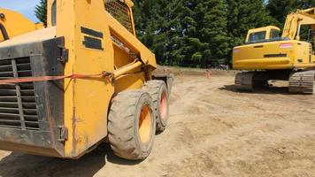 Construction workers work with excavation equipment video