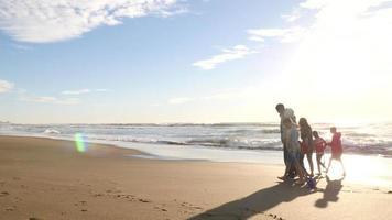 Family walking on beach video