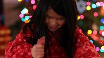 Closeup shot of young girl opening Christmas gift video