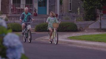 Senior couple riding bicycles together video