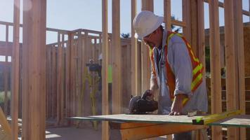 Construction worker cutting board video