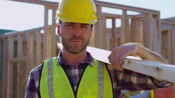 Portrait of construction worker holding board video