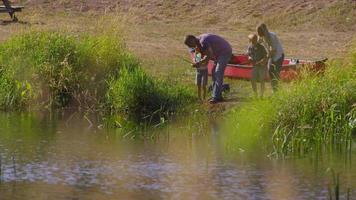 Family fishing at lake video