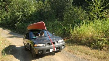 Family driving car to camp site video