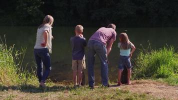Family looking at lake video