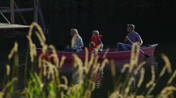 Family paddling canoe video