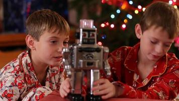 Portrait of boys with robot on Christmas video
