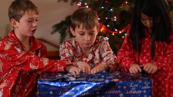 Three kids open Christmas gift together video