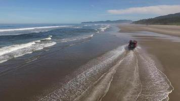 Aerial shot of 4x4 off road vehicle driving on beach video