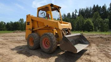 Construction worker driving excavation equipment video