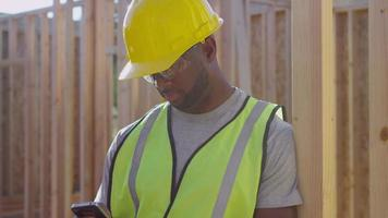 Construction worker talking on cell phone video