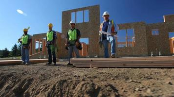 Group of construction workers standing in front of job site video