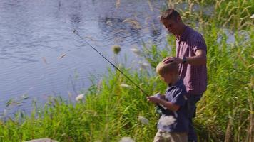 Father and son fishing at lake video