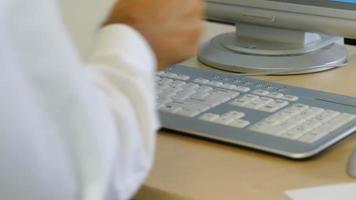 Timelapse shot of businessman typing on keyboard at office desk video