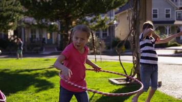 Girls playing with hula hoops at park video