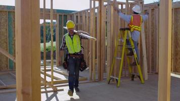 Construction worker walking with board video