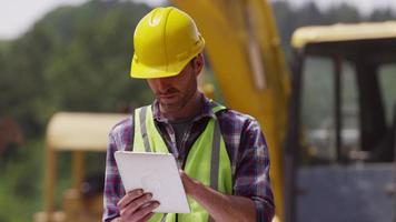 Construction worker looking over plans video