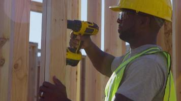 Construction worker using drill video