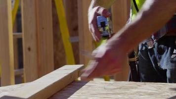 Closeup of construction worker measuring board video