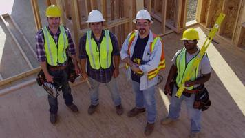 Portrait of group of construction workers on job site video