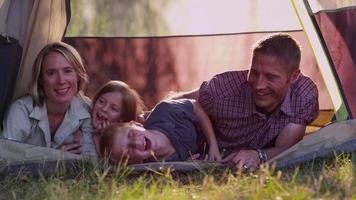 Family camping in tent video