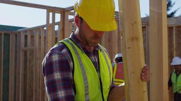 Construction worker nailing board video