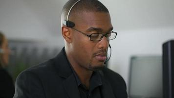 Businessman talking with headset in office video