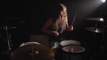 Drummer in heavy metal rock band, slow motion video
