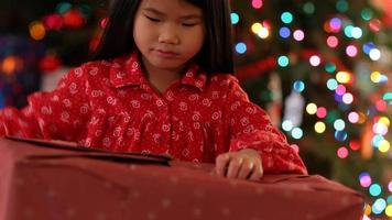Young girl opens  Christmas present video