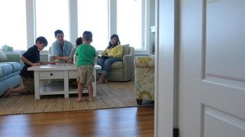 Family playing games together at beach house video