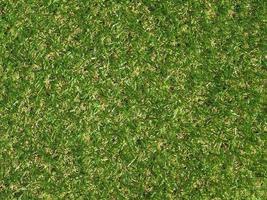 Fondo de prado de hierba sintética artificial verde foto
