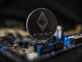 Coin ethereum on the background of a microcircuit photo